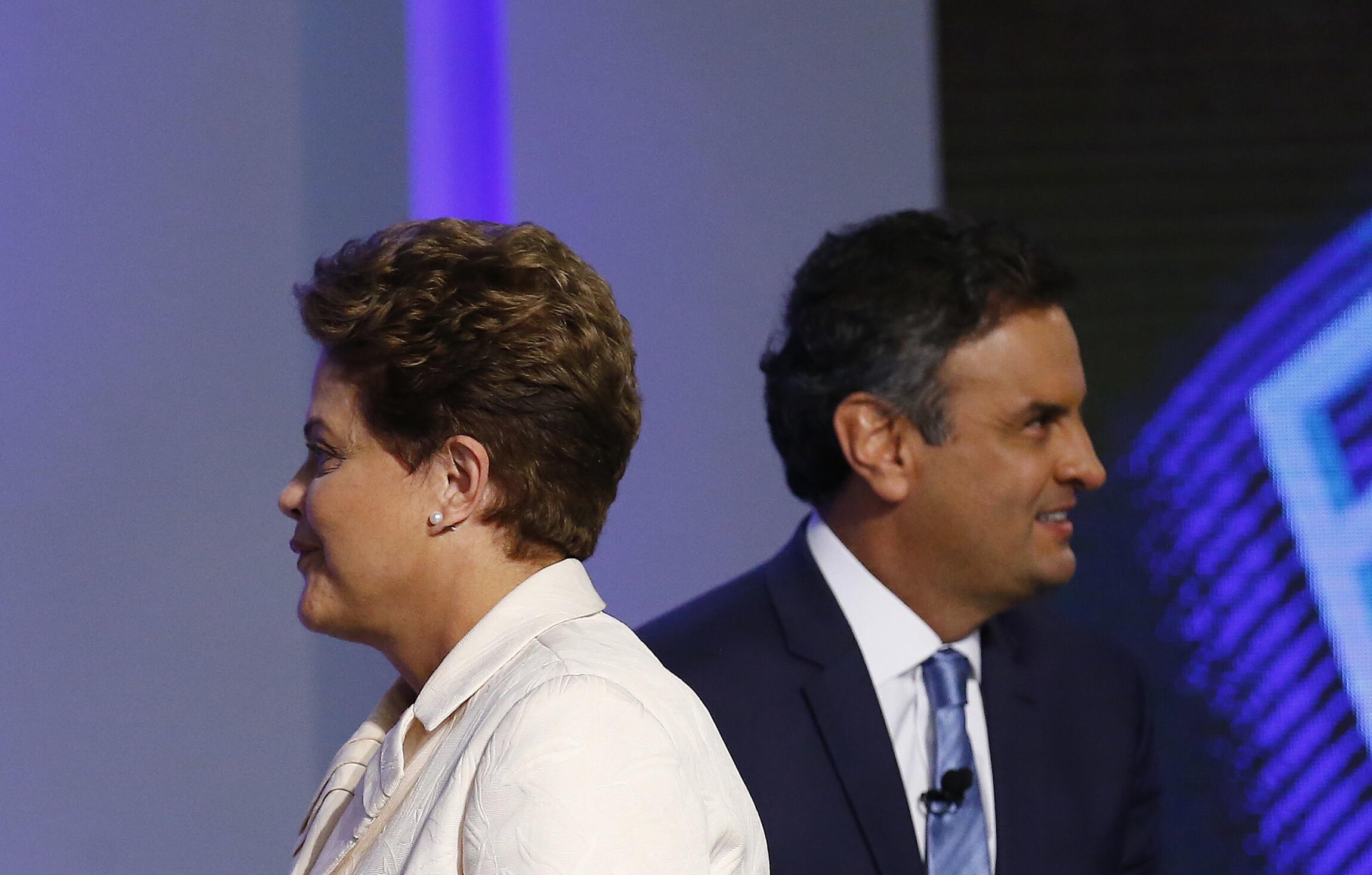 Dilma Rousseff e Aécio Neves no último debate antes do primeiro turno, quinta-feira passada (2), na rede Globo.