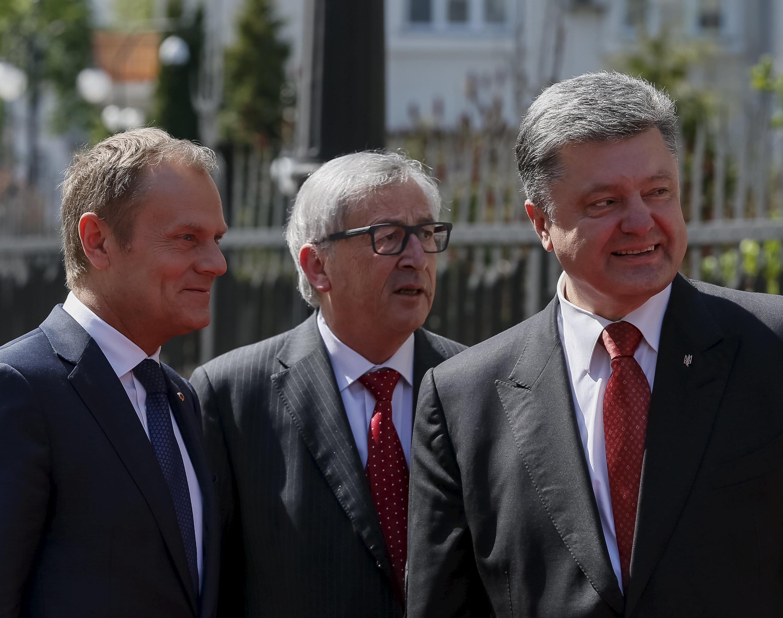European Council President Donald Tusk, European Commission President Jean Claude Juncker and Ukrainian President Petro Poroshenko are seen before their meeting in Kiev.