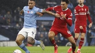 'Yan wasan Liverpool da City yayin fafatawa