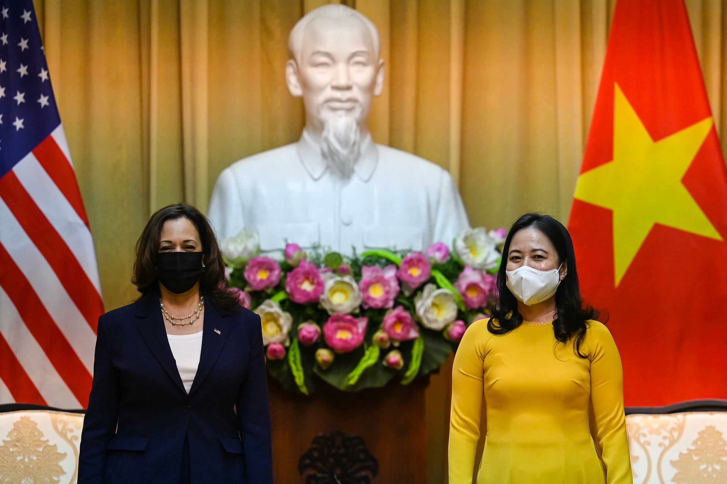 Vice President Kamala Harris (L, with Vietnam's Vice President Vo Thi Anh Xuan) is using her trip to stress US commitment to Asia