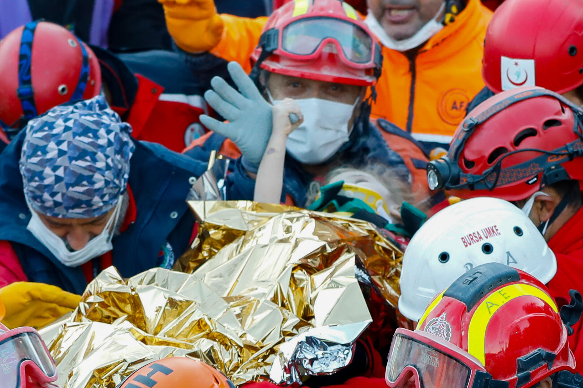 A handout picture from the Istanbul fire department shows Elif Perincek, 3, being carried out of a collapsed building after an earthquake in the Aegean port city of Izmir