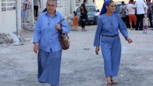 Des religieuses irakiennes à Qaraqosh, au sud-est de Mossoul, le 19 juillet 2014.