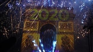 A spectacular light and sound show at Paris's Champs-Elysées avenue ushered in 2020
