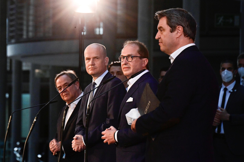 2021-04-11T145515Z_1891951861_RC2QTM9EUA3V_RTRMADP_3_GERMANY-POLITICS-CDU-CSU