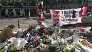 Flowers on the Champs Elysée in tribute to murdered police officer Xavier Jugelé