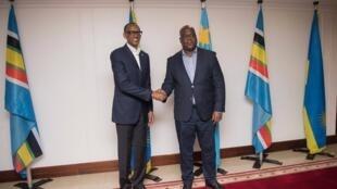 Le président rwandais Paul Kagame et son homologue congolais Felix Tshisekedi lors d'une rencontre à Kigali, le 25 mars 2019 (image d'illustration)