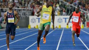Le plus grand sprinteur de tous les temps devant Tyson Gay (g) et Daniel Bailey (d), respectivement deuxième et quatrième.