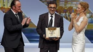 Turkish director Nuri Bilge Ceylan with Quentin Tarantino and Uma Thurman after receiving the Palme d'Or