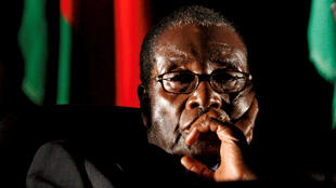 Zimbabwean President Robert Mugabe watches a video presentation during the summit of the Southern African Development Community (SADC) in Johannesburg, South Africa August 17, 2008.