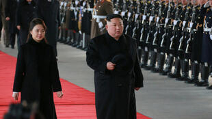 North Korean leader Kim Jung-Un and his wife Ri Sol Ju inspecting the guard of honor in Beijing