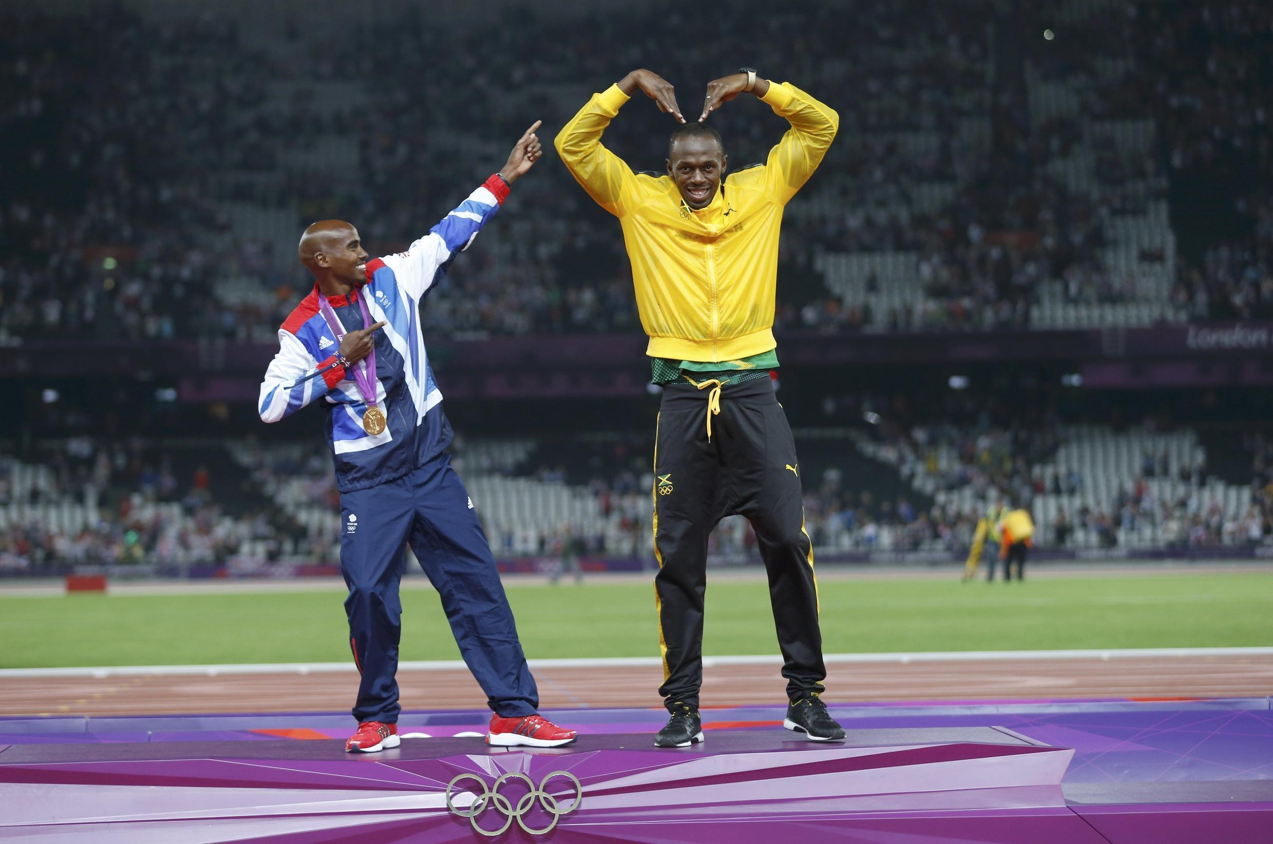 Usain Bolt celebrates with Mo Farah at the victory ceremony, 11  August, 2012