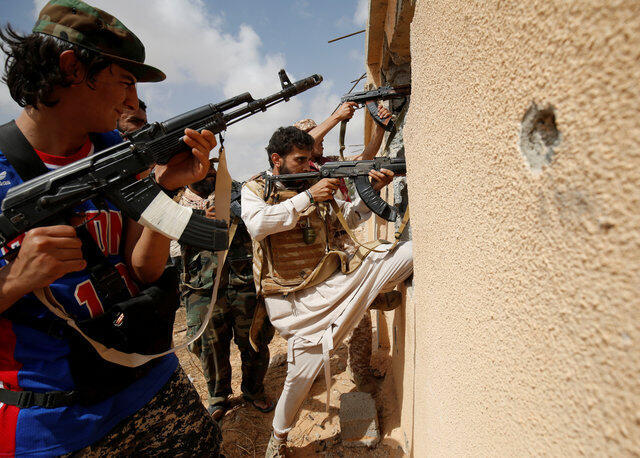 Libyan forces allied with the UN-backed government face Islamic State fighters in Sirte, Libya, 15 July 2016