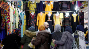 Women buy clothes at the annual Muslims of France Gathering, at Le Bourget, 30 March 2018.