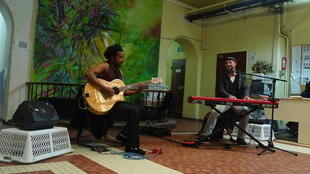 French musician Pierre Sibille (keys) and guitarist Gabriel Equerre perform at the Versailles short-stay women's prison.