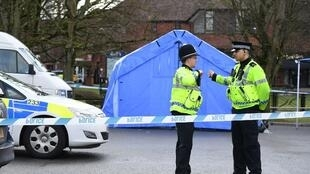 Police stand guard at a cordon in front of a police tent at the scene at The Maltings shopping centre in Salisbury, southern England, on March 6, 2018 where a man and a woman were found critically ill on a bench on March 4 and taken to hospital.