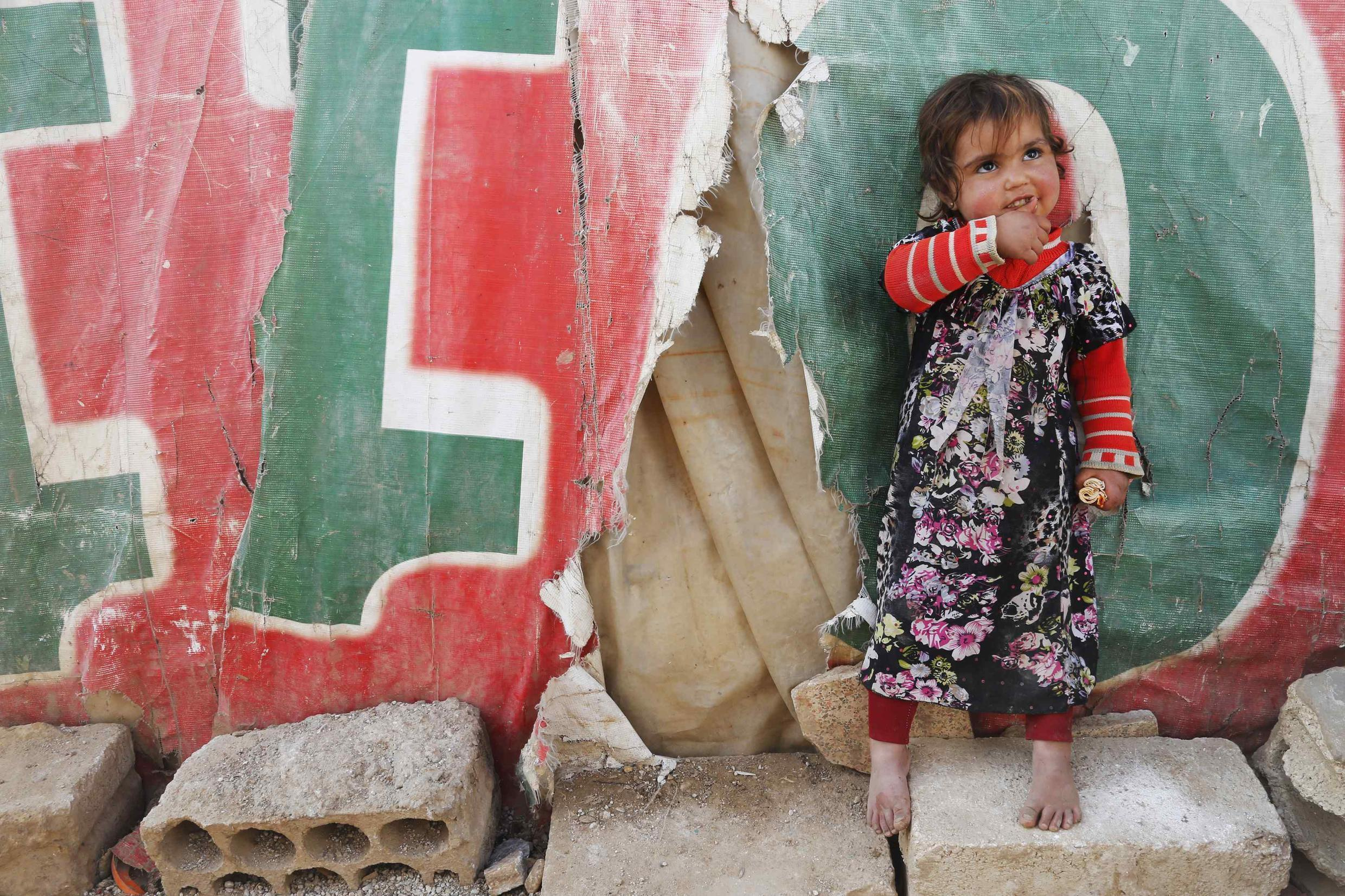A Syrian child in a  refugee camp in Lebanon's Bekaa Valley