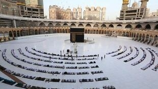 Worshippers gathering before the Kaaba at the Grand Mosque in Saudi Arabia's Mecca to attend the prayers of Eid Al Fitr.