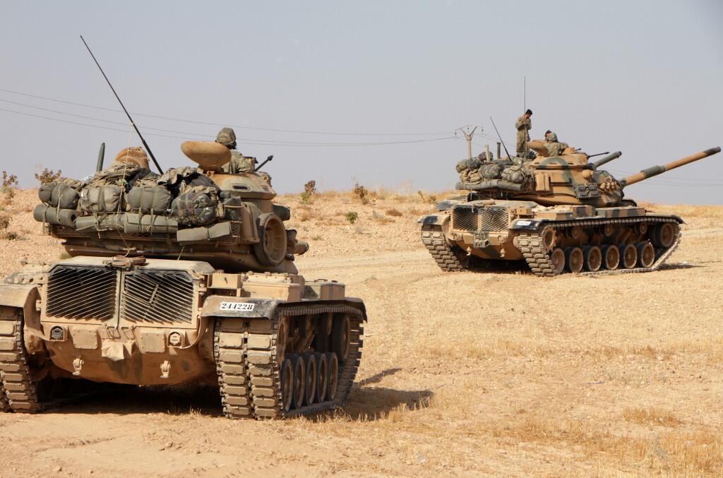 Các xe tăng M-60 của Thổ Nhĩ Kỳ tiến vào thành phố Tukhar (Manbij, miền bắc Syria) ngày 14/10/2019.