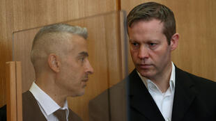 """Ernst (R with his lawyer Mustafa Kaplan) said he had carried out a """"cowardly and cruel"""" act"""