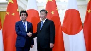 日本首相安倍晋三与中国国家主席习近平资料图片