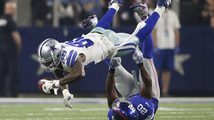 Cowboys wide receiver Dez Bryant (88) catches the ball as New York Giants cornerback Prince Amukamara (20) tackles at AT&T Stadium