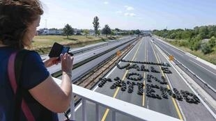 """The message """"Valls we're waiting for you"""", spelt out in tyres on the A6 motorway near Lyon"""