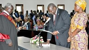 South Sudan's First Vice President Riek Machar takes the oath of office at the State House in Juba, 22 February 2020. Angelina Teny, South Sudan's Defense Minister and his wife, is to his left.