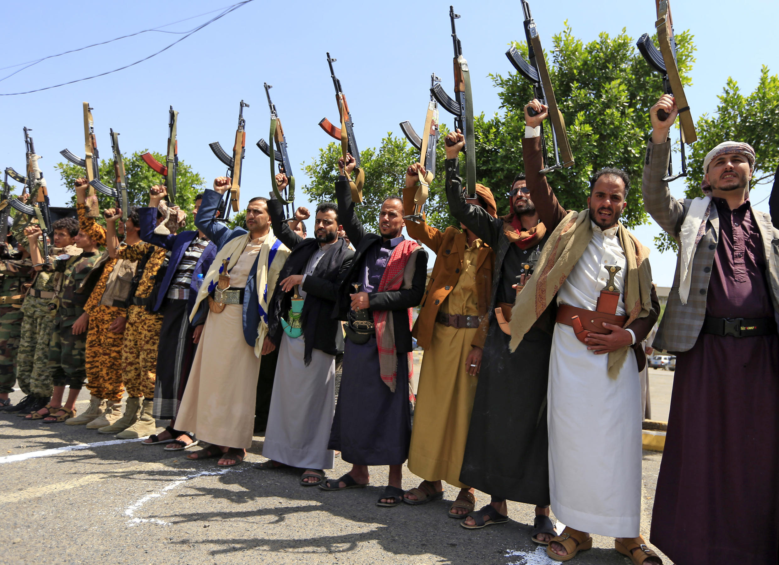 Yemeni gunmen loyal to the Huthi movement brandish their weapons during a rally in the capital Sanaa, to show support to the movement against the Saudi-led intervention in their country