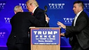 U.S. Republican presidential nominee Donald Trump is hustled off the stage by security agents after a perceived threat in the crowd, at a campaign rally in Reno, Nevada, U.S. November 5, 2016.