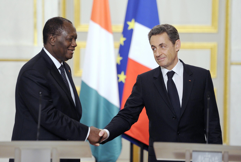 President Alassane  Ouattara and President Nicolas Sarkozy sign new security deal