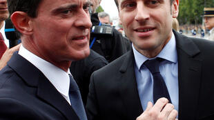Former prime minister Manuel Valls (R) with President-elect Emmanuel Macron while they were still in government