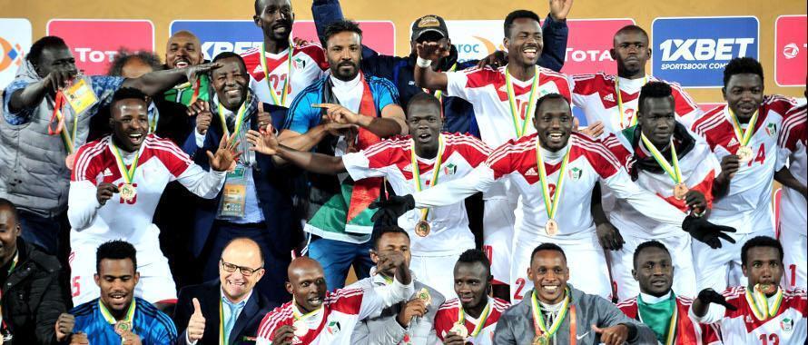 Wachezaji wa Sudan wakisherehekea baada ya kupata medali ya shaba katika mashindano ya CHAN Februari 03 2018