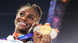 Britain's Dina Asher-Smith poses with her gold medal after winning the 200m at the 2019 world championships