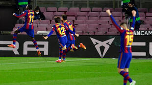 Ousmane Dembele (L) celebrates scoring the winner for Barcelona against Real Valladolid on Monday.