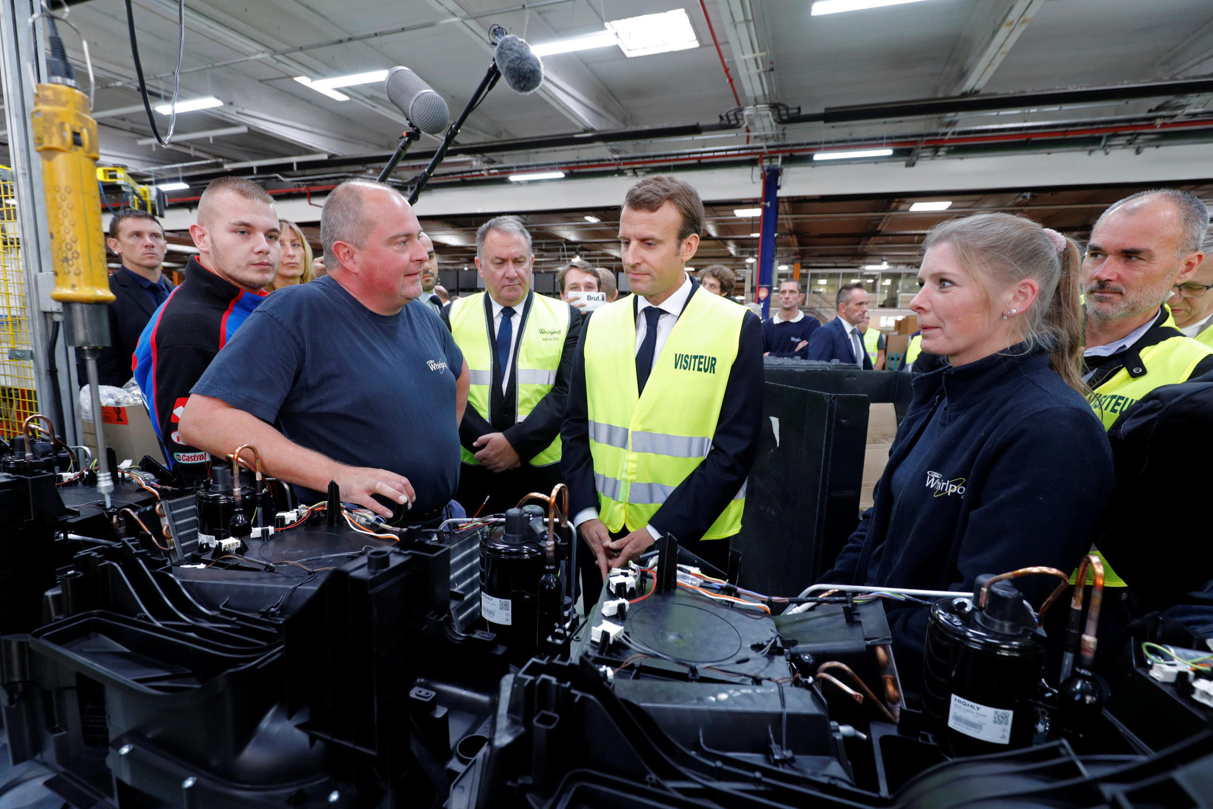 French President Emmanuel Macron talks with Whirlpool employees during a visit at the company's factory in Amiens, France, October 3, 2017.