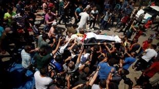 Les funérailles de l'un des trois Palestiniens tués par des militaires israéliens dans le nord de la bande de Gaza, le 18 août 2019.