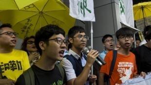 遭起訴的三位學運領袖(左起):羅冠聰,周永康,黃之峰