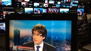 Ousted Catalan President Carles Puigdemont appears on a monitor during a live TV interview on a screen in a bar in Brussels, Belgium, November 3, 2017.