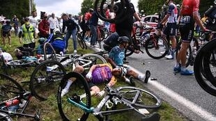 A large number of riders came off their backs after a crash caused by a spectator holding out a sign