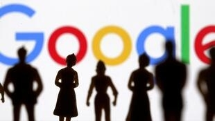 FILE PHOTO: Small toy figures are seen in front of Google logo in this illustration picture, April 8, 2019.