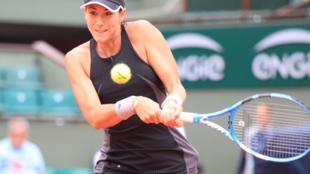 La hispano-venezolana Muguruza en accion durante los cuartos de final en Roland Garros que le enfrentaba a la Rusa Maria Sharapova el 6 de Junio de 2018.
