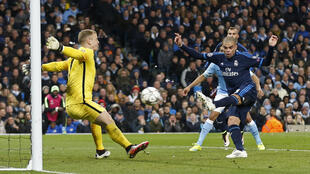 Manchester City goalkeeper Joe Hart saves a ferocious shot from Real Madrid's Pepe during the first leg of their semifinal encounter.