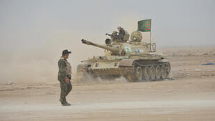 Des forces irakiennes lors d'une opération contre le groupe EI dans le district d'al-Shura, le 28 octobre.