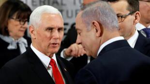 Conférence de Varsovie sur la sécurité au Moyen-Orient: Mike Pence, vice-président américain, aux côtés du Premier ministre israélien Benaymin Netanyahu, le 14 février 2019.