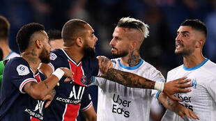 Ready for a rematch: Neymar (left) and Marseille's Spanish defender Alvaro (right) had to be separated in a bad tempered match in September