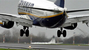 A Ryanair airplane lands at Liverpool's John Lennon airport  in England.