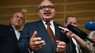 Papua New Guinea's former prime minister Peter O'Neill (C), pictured here in November 2018, has been arrested