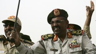 Sudan President Omar Hassan al-Bashir (R) and Defense Minister Abdel Raheem Muhammad Hussein at the Popular Defense Force rally