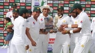 The Pakistan cricket team celebrates after winning the Test series against Australia in Abu Dhabi.
