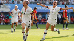 Megan Rapinoe of USA celebrates goal number two against Spain with Alex Morgan, 24 June 2019.